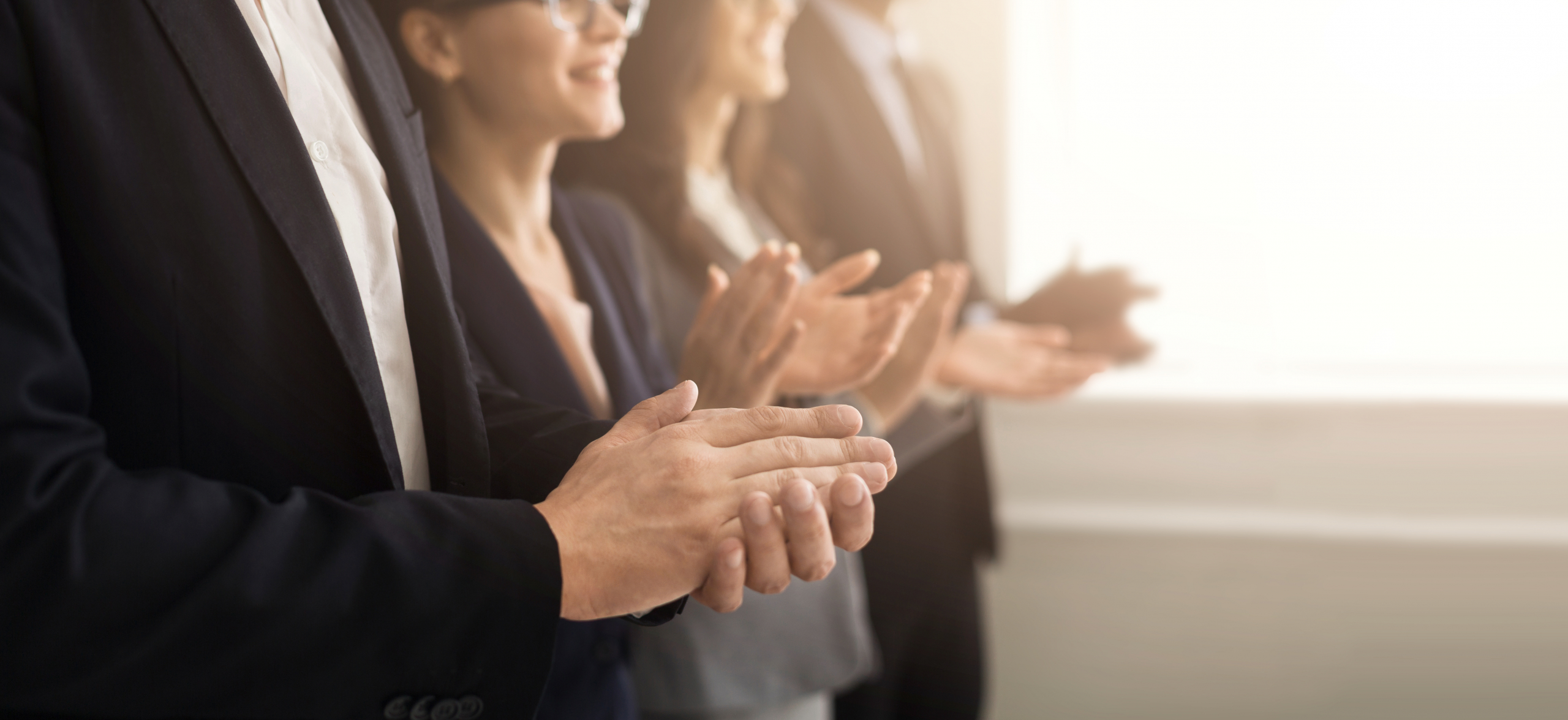 Business people hands applauding at meeting